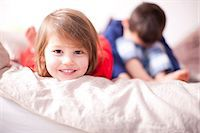 Portrait of young girl smiling and brother sulking Stock Photo - Premium Royalty-Freenull, Code: 649-07063624