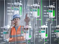 Factory supervisor monitoring product levels on interactive display Stock Photo - Premium Royalty-Freenull, Code: 649-07063666