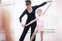 Young ballerina practicing pose with teacher Stock Photo - Premium Royalty-Freenull, Code: 649-07063685