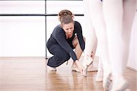 Teacher adjusting teenage ballerinas feet pose Stock Photo - Premium Royalty-Freenull, Code: 649-07063712