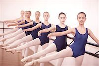 Row of teenage ballerinas with legs outstretched Stock Photo - Premium Royalty-Freenull, Code: 649-07063714