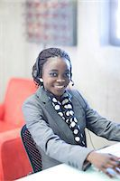 switchboard operator - Young woman using telephone headset in office Stock Photo - Premium Royalty-Freenull, Code: 649-07063903