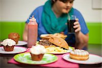 Young woman in cafe with table of food Stock Photo - Premium Royalty-Freenull, Code: 649-07064049