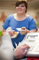 Young woman paying for takeaway order in cafe Stock Photo - Premium Royalty-Freenull, Code: 649-07064055