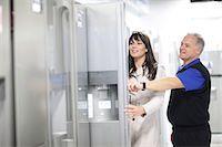 fridge - Woman looking at refrigerators in showroom Stock Photo - Premium Royalty-Freenull, Code: 649-07064078
