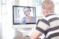 Man using computer for video call Stock Photo - Premium Royalty-Freenull, Code: 649-07064186