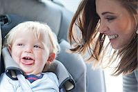 Mother with baby son in back seat of car Stock Photo - Premium Royalty-Freenull, Code: 649-07064196