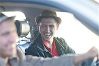 Two young men driving in car Stock Photo - Premium Royalty-Freenull, Code: 649-07064221