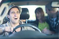 Young adult friends driving in car Stock Photo - Premium Royalty-Freenull, Code: 649-07064222