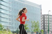 Young woman jogging in city Stock Photo - Premium Royalty-Freenull, Code: 649-07064316