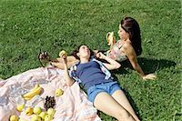 Two young females sharing a picnic Stock Photo - Premium Royalty-Freenull, Code: 649-07064320