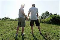Two young men walking and holding hands Stock Photo - Premium Royalty-Freenull, Code: 649-07064324