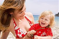 Mother and daughter smiling at beach Stock Photo - Premium Royalty-Freenull, Code: 649-07064517