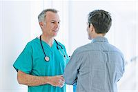 Surgeon talking to man Stock Photo - Premium Royalty-Freenull, Code: 649-07064717