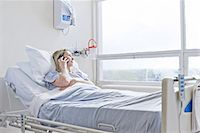people hospital - Patient lying on hospital bed on telephone call Stock Photo - Premium Royalty-Freenull, Code: 649-07064763