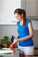 Woman cutting red pepper Stock Photo - Premium Royalty-Freenull, Code: 649-07064784