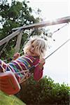 Girl Laughing on Swing in Yard, Mulheim, North Rhine-Westphalia, Germany Stock Photo - Premium Rights-Managed, Artist: Anne Wirtz, Code: 700-07066886