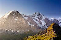 snow capped - View from Kleine Scheidegg on Mount Eiger, with Monch and Jungfrau at Sunrise, Bernese Alps, Switzerland Stock Photo - Premium Rights-Managednull, Code: 700-07066997
