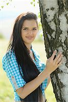 Portrait of young woman standing beside tree, Bavaria, Germany Stock Photo - Premium Rights-Managednull, Code: 700-07067357