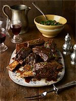 fork - Beef Ribs on Platter with Side Dish and Glasses of Red Wine, Studio Shot Stock Photo - Premium Royalty-Freenull, Code: 600-07067609