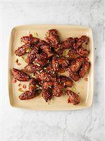 food - Overhead View of Chicken Wings, Studio Shot Stock Photo - Premium Royalty-Freenull, Code: 600-07067616