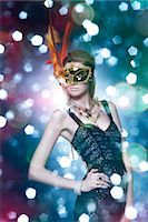 lady wearing a golden feather mask in a party Stock Photo - Premium Royalty-Freenull, Code: 613-07067977