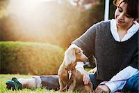 woman and dog sitting in the park Stock Photo - Premium Royalty-Freenull, Code: 613-07068310