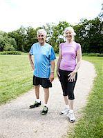 Mature couple running in nature Stock Photo - Premium Royalty-Freenull, Code: 613-07068334