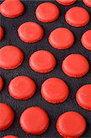 slate - Freshly baked red macaroon halves on a slate surface Stock Photo - Premium Royalty-Freenull, Code: 659-07068863