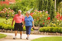 Senior Couple Walking in a Park Stock Photo - Premium Royalty-Freenull, Code: 6106-07070002