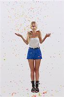people falling - young woman with confetti flying Stock Photo - Premium Royalty-Freenull, Code: 6106-07070217