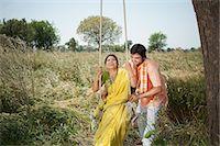 pushing - Farmer pushing his wife on a swing in the field, Sohna, Haryana, India Stock Photo - Premium Royalty-Freenull, Code: 630-07071143