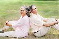 Mature couple sitting back to back on grass in a park, Lodi Gardens, New Delhi, India Stock Photo - Premium Royalty-Freenull, Code: 630-07071281