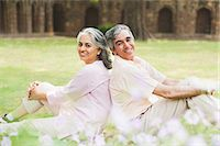 Mature couple sitting back to back on grass in a park, Lodi Gardens, New Delhi, India Stock Photo - Premium Royalty-Freenull, Code: 630-07071282