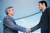 east indian (male) - Businessman shaking hands with another businessman Stock Photo - Premium Royalty-Freenull, Code: 630-07071496