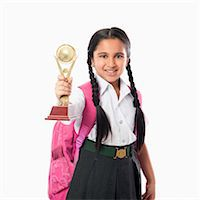 school girl uniforms - Schoolgirl holding a trophy Stock Photo - Premium Royalty-Freenull, Code: 630-07071794