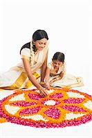 east indian mother and children - South Indian woman making a rangoli of flowers with her daughter at Onam Stock Photo - Premium Royalty-Freenull, Code: 630-07071860