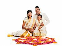 South Indian family making a rangoli of flowers at Onam Stock Photo - Premium Royalty-Freenull, Code: 630-07071861