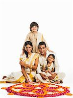 South Indian family making a rangoli of flowers at Onam Stock Photo - Premium Royalty-Freenull, Code: 630-07071862