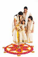 South Indian family lighting oil lamp at Onam Stock Photo - Premium Royalty-Freenull, Code: 630-07071864