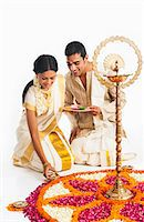 South Indian couple making a rangoli of flowers at Onam Stock Photo - Premium Royalty-Freenull, Code: 630-07071867