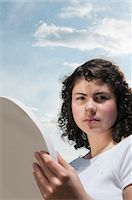 preteen beauty - Girl outdoors holding mirror Stock Photo - Premium Royalty-Freenull, Code: 628-07072101