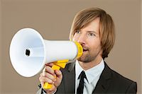 Businessman holding megaphone Stock Photo - Premium Royalty-Freenull, Code: 628-07072196