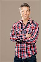 Smiling man wearing checkered shirt Stock Photo - Premium Royalty-Freenull, Code: 628-07072238