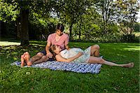expectation - Man and pregnant woman on a blanket in a park Stock Photo - Premium Royalty-Freenull, Code: 628-07072353
