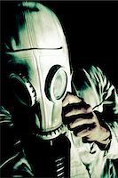 people in panic - Man wearing a gas mask Stock Photo - Premium Royalty-Freenull, Code: 628-07072643