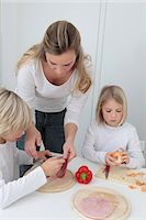 sister - Mother and two children preparing meal Stock Photo - Premium Royalty-Freenull, Code: 628-07072741