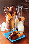 Raisin Croquants dipped in chocolate,glass and jug of milk Stock Photo - Premium Rights-Managed, Artist: Photocuisine, Code: 825-07077901