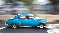 Panned' shot of old American car to capture sense of movement, Prado, Havana Centro, Cuba, West Indies, Central America Stock Photo - Premium Rights-Managednull, Code: 841-07081798