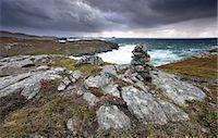 Dramatic rocky coastline above Gearrannan Blackhouse Village, near Carloway, Isle of Lewis, Outer Hebrides, Scotland, United Kingdom, Europe Stock Photo - Premium Rights-Managednull, Code: 841-07081853